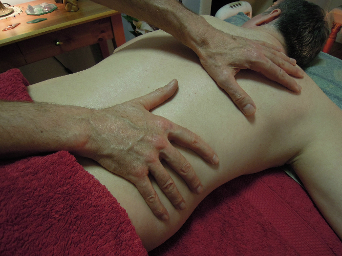 Image of Hands on back for Relaxing Therapeutic Massage Massage For Men Edinburgh with Jim