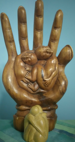 Image of wooden hand and couple for Massage For Men Edinburgh